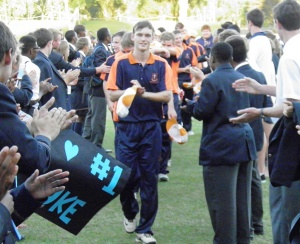 Victorious captain Donald Patterson leading Treverton off the filed after beating Howing in the secondary schools final.